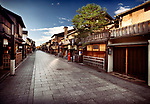 Empty Hanamikoji Dori street in Gion district in morning sunrise with closed shops, restaurants and tea houses built of wood in traditional Japanese architectural style. Hanami-koji, Gionmachi Minamigawa, Higashiyama Ward, Kyoto, Japan 2017.