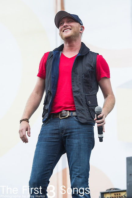 Cole Swindell performs on Day One of the 2014 CMA Music Festival in Nashville, Tennessee.