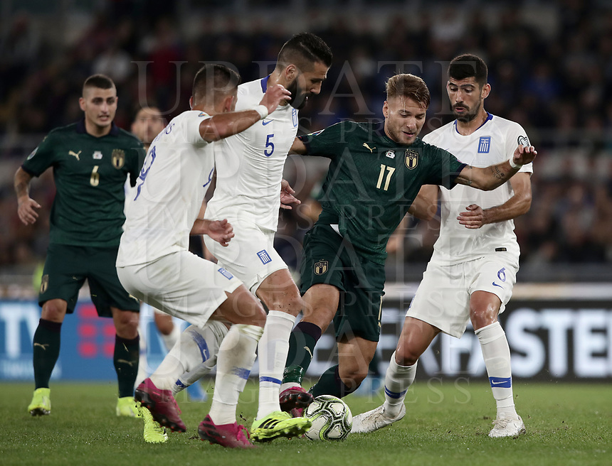 Football: Euro 2020 Group J qualifying football match Italy vs Greece at the Olympic stadium, in Rome, on October 12, 2019.<br /> Italy's Ciro Immobile (c) in action with Greece's Andreas Bouchalakis (r) and Dimitris Slovas (l) during the Euro 2020 qualifying football match between Italy and Greece at the Olympic stadium, in Rome, on October 12, 2019.<br /> UPDATE IMAGES PRESS/Isabella Bonotto