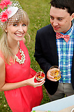 USA, Tennessee, Nashville, Iroquois Steeplechase, a young man and woman drink Moonshine Cherry-Basil Blush and Tennessee Whiskey