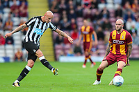 Jonjo Shelvey of Newcastle United and Nicky Law of Bradford City during the pre season friendly match between Bradford City and Newcastle United at the Northern Commercial Stadium, Bradford, England on 26 July 2017. Photo by Thomas Gadd.