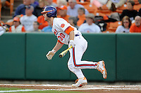 Clemson Tigers  catcher Garrett Boulware #30 swings at a pitch during a game against the Virginia Cavaliers  at Doug Kingsmore Stadium on March 15, 2013 in Clemson, South Carolina. The Cavaliers won 6-5.(Tony Farlow/Four Seam Images).