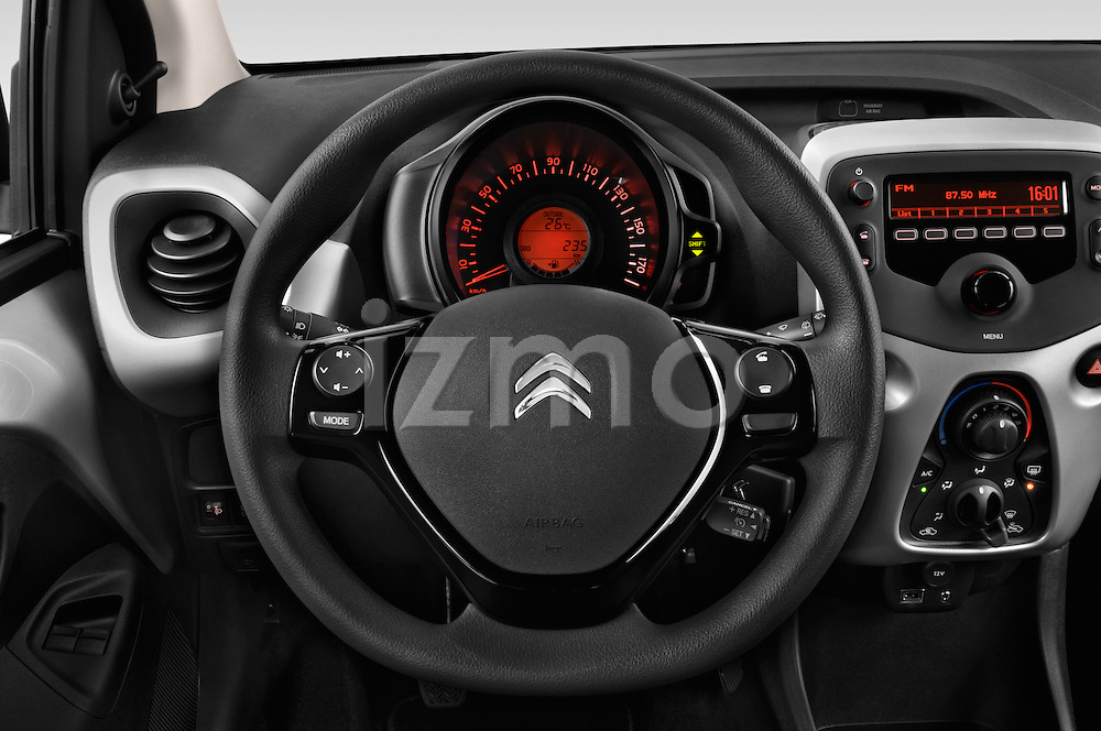 Car pictures of steering wheel view of a 2015 Citroen C1 Airscape-Feel-Edition 3 Door Micro Car Steering Wheel