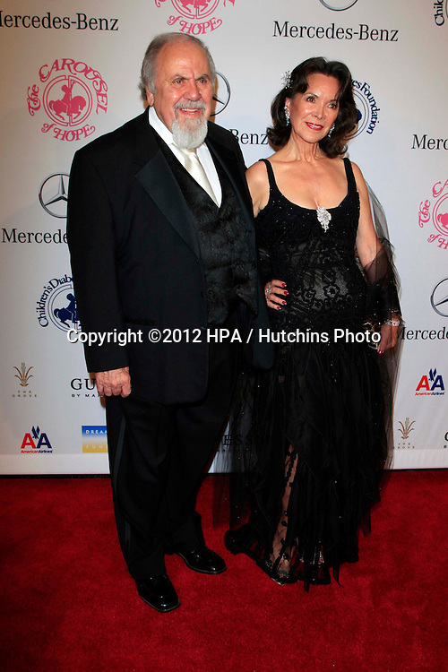 LOS ANGELES - OCT 20:  George Schlatter, wife Jolene arrives at  the 26th Carousel Of Hope Ball at Beverly Hilton Hotel on October 20, 2012 in Beverly Hills, CA