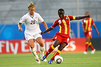 USA's Amber Brooks (L) and Elizabeth Addo of Ghana during the FIFA U20 Women World Cup at the Rudolf Harbig Stadium in Dresden, Germany on July 14th, 2010.