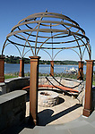 View of the outdoor Fire Pit off the pool with the boat and dock in the background at the home of Pete and Judi Dawkins on the Navesink River in Rumson, New Jersey. CREDIT: Bill Denver for the Wall Street Journal..NYHODRUMSON