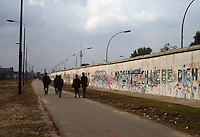 People walking along the remnants of the Berlin Wall, with the Fernsehturm Tower in the background, Berlin, Germany