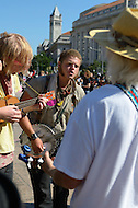 "October 6, 2011  (Washington, DC)  A banjo player from Houston, Texas, who called himself Banjo Youngblood (center), during an impromptu jam session at Freedom Plaza.  Hundreds of people from around the country descended on Washington for ""Occupy DC"", a movement that has spread from New York City's ""Occupy Wall Street""    (Photo by Don Baxter/Media Images International)"