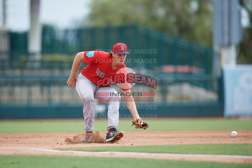 Boston Red Sox Triston Casas (19) fields a ground ball during a Florida Instructional League game against the Baltimore Orioles on October 8, 2018 at the Ed Smith Stadium in Sarasota, Florida.  (Mike Janes/Four Seam Images)