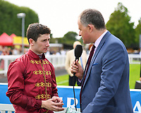 Jockey Oisin Murphy is interviewed after winning The Tattersalls Sovereign Stakes on Kick On during Horse Racing at Salisbury Racecourse on 15th August 2019