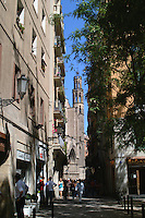 Street scene featuring a church spire in Barcelona, Spain.