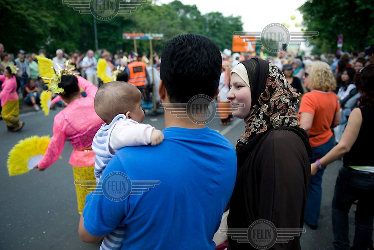 Members of the Muslim community at the Carnival of Cultures parade in the Kreuzberg district of Berlin. The carnival celebrates Berlin's ethnic and cultural diversity.