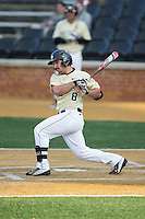 Joey Rodriguez (8) of the Wake Forest Demon Deacons follows through on his swing against the UConn Huskies at Wake Forest Baseball Park on March 17, 2015 in Winston-Salem, North Carolina.  The Demon Deacons defeated the Huskies 6-2.  (Brian Westerholt/Four Seam Images)