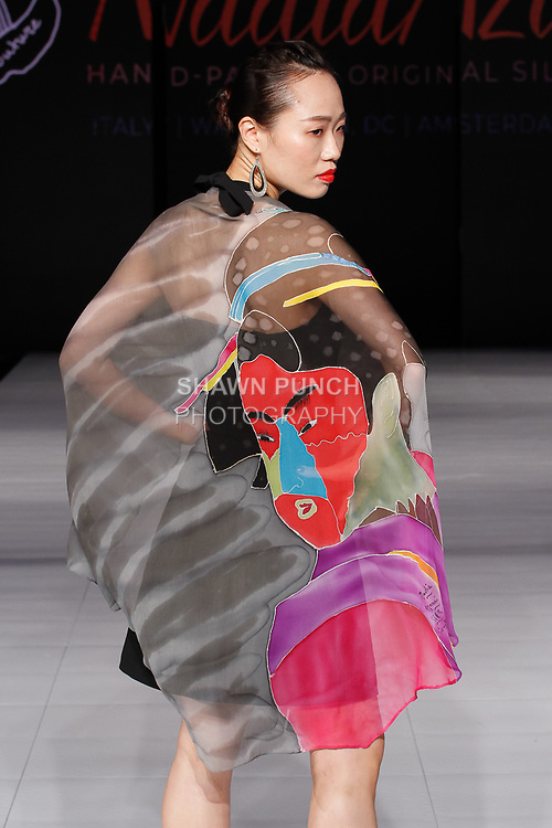 Model walks runway in a silk hand painted scarf by Nadia Azumi , during Society Fashion Week Spring Summer 2019 in New York City on September 7, 2018.