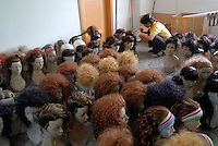 Hair for mannequins is prepared at the Gia Mannequin factory in Dongguan, China. The process of mannequin manufacturing involves the use of toxic cancer causing resin and the use of fibre glass that creates a poisonous dust. The workers are paid higher wages to work in such conditions..12 Jun 2007