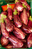 Fresh aubergines in a market