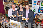5097-5100.---------.Food for thought.----------------.L-R Artie Clifford and his daughter Keady,Dingle Seafood's with Nick Foley of Blender's sauces Ireland Ltd serve up some delicious food in Curren's bar main St Dingle last Saturday afternoon,as part of the Dingle Peninsula Food&Wine Festival last weekend.