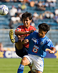 Cruz Azul defender Alberto Rodriguez (R) fights for the ball with Veracruz Tiburones Rojos midfielder Omar Rivera during their soccer match in the Azul Stadium in Mexico City, April 8, 2006. Cruz Azul won 3-0 to Veracruz. .. Photo by © Javier Rodriguez