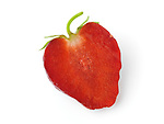 Closeup of a cut in half red organic homegrown strawberry slice isolated on white background