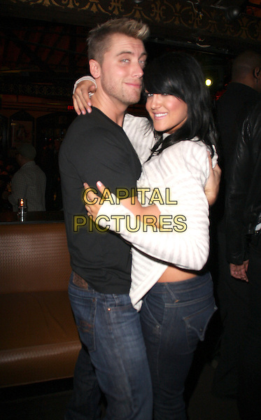 "LANCE BASS, LACEY SCHWIMMER.""Dancing With The Stars""  Home Coming Party held at The Abbey, West Hollywood, CA, USA, .13th February 2009..half length hugging posing black white top .CAP/ADM/KB.©Kevan Brooks/Admedia/Capital PIctures"