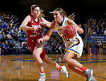 BROOKINGS, SD - FEBRUARY 4:  Kerri Young #10 from South Dakota State drives against Jaycee Bradley #12 from the University of South Dakota during their game Saturday afternoon at Frost Arena in Brookings. (Photo by Dave Eggen/Inertia)