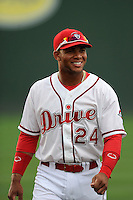 Second baseman Yoan Moncada (24) of the Greenville Drive works out before a game against the Lexington Legends on Monday, May 18, 2015, at Fluor Field at the West End in Greenville, South Carolina. Moncada, a 19-year-old prospect from Cuba, made his professional debut tonight in the Red Sox organization. (Tom Priddy/Four Seam Images)