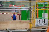 Security guard at the construction site of the London 2012 Olympic Games, Stratford.