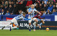 West Ham United's Felipe Anderson gets past Huddersfield Town's Florent Hadergjonaj and Aaron Mooy<br /> <br /> Photographer Rob Newell/CameraSport<br /> <br /> The Premier League - Huddersfield Town v West Ham United - Saturday 10th November 2018 - John Smith's Stadium - Huddersfield<br /> <br /> World Copyright © 2018 CameraSport. All rights reserved. 43 Linden Ave. Countesthorpe. Leicester. England. LE8 5PG - Tel: +44 (0) 116 277 4147 - admin@camerasport.com - www.camerasport.com