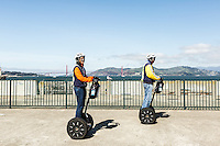 A Segway tour with the San Francisco Electric Tour Company takes you onto Aquatic Park Pier in San Francisco Maritime Historic Park. San Francisco, California.