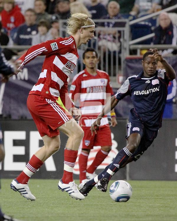 New England Revolution midfielder Sainey Nyassi (14) and FC Dallas midfielder/forward Brek Shea(20) compete for the ball.  The New England Revolution drew FC Dallas 1-1, at Gillette Stadium on May 1, 2010
