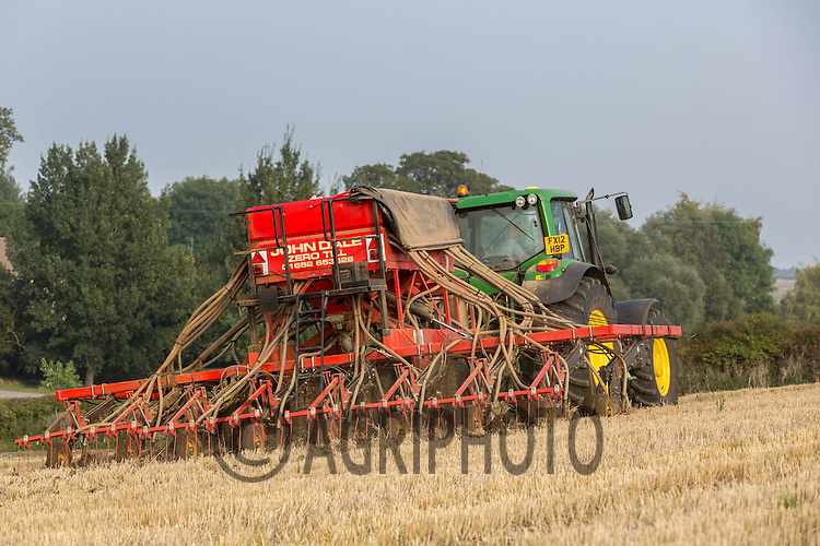 John Deere tractor and Dale drill direct drilling Wheat into Barley Stubble<br /> Picture Tim Scrivener 07850 303986