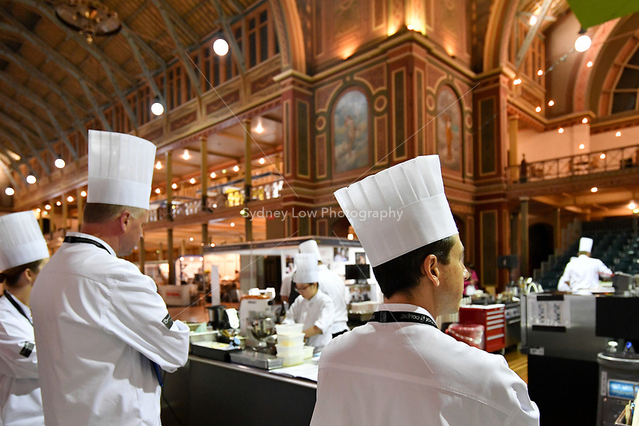 Melbourne, 30 May 2017 - The kitchen invigilators Glenn Flood from the ALH Group, John McFadden from the Parkroyal Hotel Darling Harbour, and Karen Doyle from Le Cordon Bleu watch the competitors at the Australian selection trials of the Bocuse d'Or culinary competition held during the Food Service Australia show at the Royal Exhibition Building in Melbourne, Australia. Photo Sydney Low
