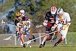 Palos Verdes, CA 03/30/10 - Hunter Grasinger (Peninsula #17), David Lee (Peninsula #29) and Ryan Brothers (Palos Verdes #8) in action during the Palos Verdes-Peninsula JV Boys Lacrosse game.