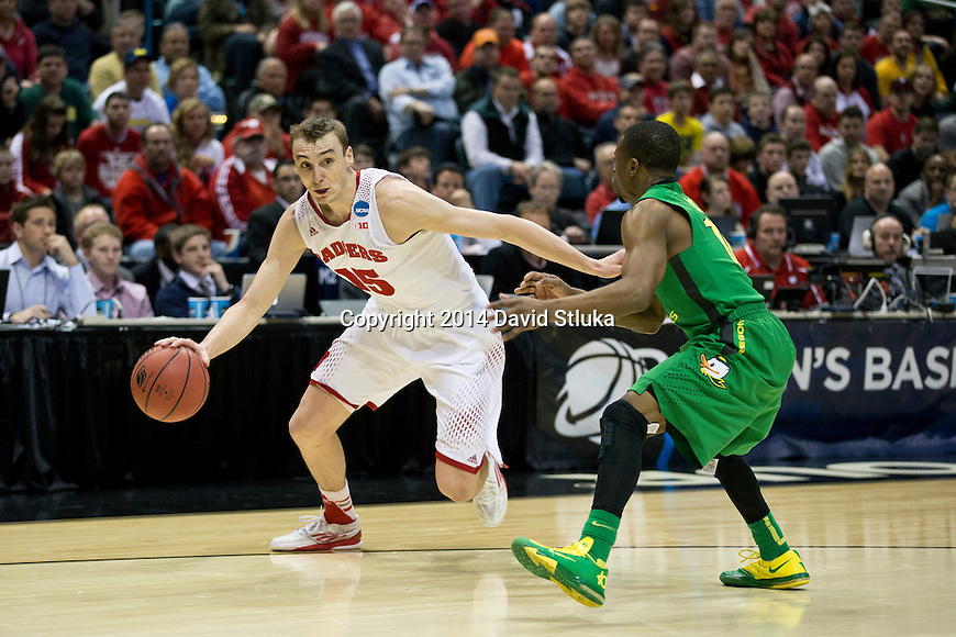Wisconsin Badgers forward Sam Dekker (15) drives to the basket during the third-round game in the NCAA college basketball tournament against the Oregon Ducks Saturday, April 22, 2014 in Milwaukee. The Badgers won 85-77. (Photo by David Stluka)