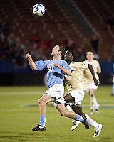 North Carolina forward Brian Shriver (31) and Wake Forest defender Ike Opara (23) eye the ball.  North Carolina Tar Heels defeated Wake Forest Demon Deacons 1-0 in the semifinal match of the NCAA Men's College Cup at Pizza Hut Park in Frisco, TX on December 12, 2008.  Photo by Wendy Larsen/isiphotos.com