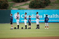 Young baseball players take the field for the National Anthem with Kannapolis Intimidators outfielders (L-R) Jameson Fisher (11), Joel Booker (23), and Micker Aldofo (27) prior to the game against the Asheville Tourists at Kannapolis Intimidators Stadium on May 5, 2017 in Kannapolis, North Carolina.  The Tourists defeated the Intimidators 5-1.  (Brian Westerholt/Four Seam Images)