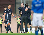 St Johnstone v Dundee...13.09.14  SPFL<br /> Gary Harkins gets a hug from manager Paul Hartley at full time<br /> Picture by Graeme Hart.<br /> Copyright Perthshire Picture Agency<br /> Tel: 01738 623350  Mobile: 07990 594431
