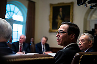 Steven Mnuchin, U.S. Treasury secretary, listens as U.S. President Donald Trump speaks during a cabinet meeting in the Cabinet Room of the White House, on Wednesday, Jan. 2, 2019 in Washington, D.C. Photo Credit: Al Drago/CNP/AdMedia