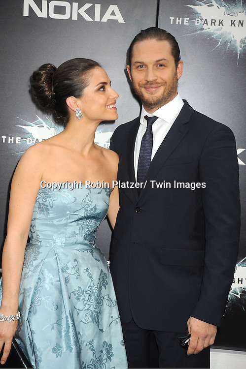 "Tom Hardy and date attends the world premiere of ""The Dark Knight Rises"" on .July 16, 2012 at The AMC Lincoln Square Imax Theatre in New York City. The movie stars Christian Bale, Gary Oldman, Anne Hathaway, Tom Hardy, Marion Cotillard, Joseph Gordon-Levitt and Morgan Freeman."