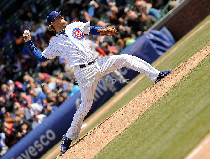 ANDREW CASHNER, of the Chicago Cubs , in actions during the Cubs game against the Arizona Diamondbacks at Wrigley FIeld on April 5, 2011.  The Cubs won the game beating the Diamondbacks 6-5.