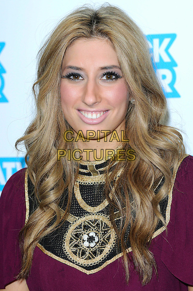 "STACEY SOLOMON .X Factor 2009 Finalists launch ""The Gatwick Factor"", helping raise money for Great Ormand Street hospital. .Gatwick Airport, London, England, UK, .16th December 2009..photocall portrait headshot smiling maroon  purple  gold black pattern patterned wavy hair .CAP/FIN.©Steve Finn/Capital Pictures."