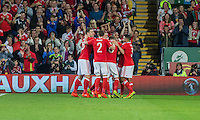 Joe Allen of Wales is mobbed after scoring his side's second goal during the FIFA World Cup Qualifier match between Wales and Moldova at Cardiff City Stadium, Cardiff, Wales on 5 September 2016. Photo by Mark  Hawkins.