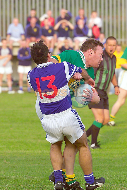 Sean O'M's Gerry Dooner holds on the the ball for dear life as Robbie McCrave tries to get it.Photo Fran Caffrey/Newsfile.ie..This picture has been sent to you by:.Newsfile Ltd,.3 The View,.Millmount Abbey,.Drogheda,.Co Meath..Ireland..Tel: +353-41-9871240.Fax: +353-41-9871260.GSM: +353-86-2500958.ISDN: +353-41-9871010.IP: 193.120.102.198.www.newsfile.ie..email: pictures@newsfile.ie..This picture has been sent by Fran Caffrey.francaffrey@newsfile.ie