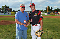 Batavia Muckdogs guest Jerry Maley with pitcher Travis Neubeck (13) after throwing out the ceremonial first pitch before a game against the State College Spikes on June 22, 2016 at Dwyer Stadium in Batavia, New York.  State College defeated Batavia 11-1.  (Mike Janes/Four Seam Images)