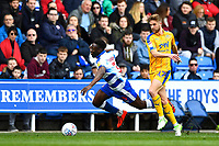 Andy Yiadom of Reading is caught by Michael Jacobs of Wigan Athletic during Reading vs Wigan Athletic, Sky Bet EFL Championship Football at the Madejski Stadium on 9th March 2019