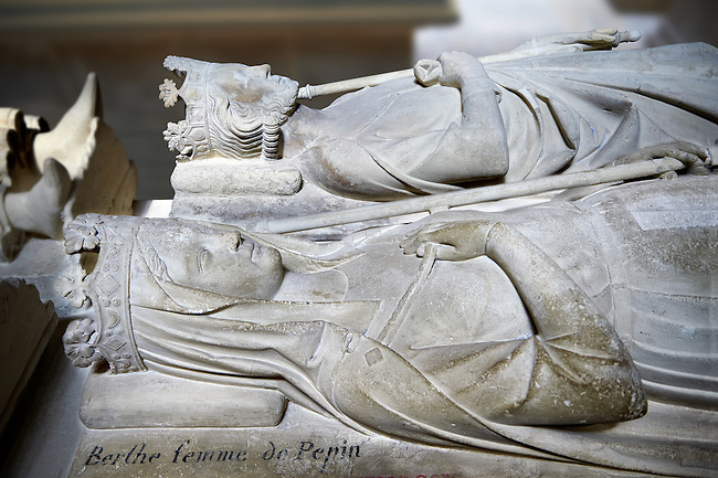 Medieval tomb and statue of Pepin le Bref (714 - 768), King of France 751 - 768, and his wife Berthe in the foreground (726 - 782).. The Gothic Cathedral Basilica of Saint Denis ( Basilique Saint-Denis ) Paris, France.  A UNESCO World Heritage Site.