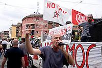 Roma, 25 Aprile 2015<br /> Manifestazione meticcia, antifascista, e contro il razzismo al quartiere  Tor Sapienza per il  giorno del  70esimo anniversario della Liberazione dal nazi-fascismo. Nella foto:  Militant A di Assalti Frontali.<br /> Rome, April 25, 2015<br /> Demostration antifascist, and  against racism to the neighborhood Tor Sapienza for the day of the 70th anniversary of the liberation from Nazi-Fascism.