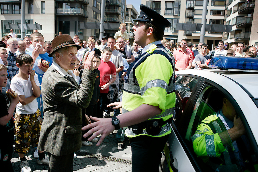 A man is upset with the Gardai for blocking the trotters at the Smithfield Horse Market,  Dublin, Ireland .Picture James Horan
