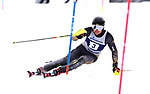 FRANCONIA, NH - MARCH 10:  David Ketterer of the University of Colorado hits a gate during the Men's Slalom event at the Division I Men's and Women's Skiing Championships held at Cannon Mountain on March 10, 2017 in Franconia, New Hampshire. Ketterer won the event over William St. Germain of the University of Vermont by four-tenths of a second.  (Photo by Gil Talbot/NCAA Photos via Getty Images)