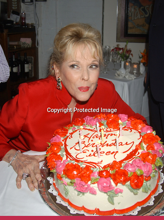 ..Eileen Fulton with her 70th Birthday cake..at Eileen Fulton's show on September 12, 2003 at Don't Tell Mama celebrating her 70th Birthday. there was an after party at La Rivista afterwards.                                                          Photo by Robin Platzer, Twin Images